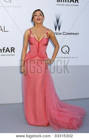 ANTIBES - MAY 24: Rose McGowan at the 2012 amfAR's Cinema Against AIDS at Hotel Du Cap on May 24, 2012 in Antibes, France