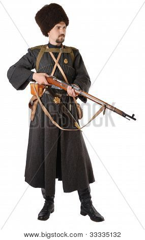 Man In Vintage Costume Of Russian Cossack With A Rifle.