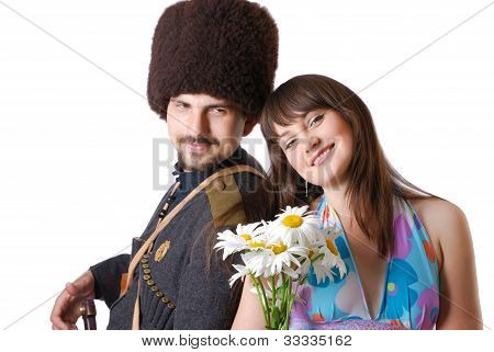 Youth Man In Military And Girlfriend With Flowers.