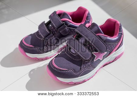 poster of Purple Sneakers On White Background With Copy Space. Top View. Running Shoes With Laces.pair Of Spor