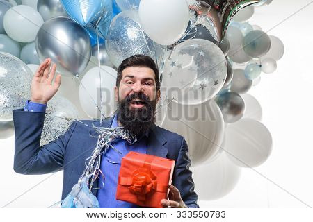 poster of Handsome Man Celebrating Something. Bearded Man In Suit Holds Birthday Gift. Festive Event Or Birthd