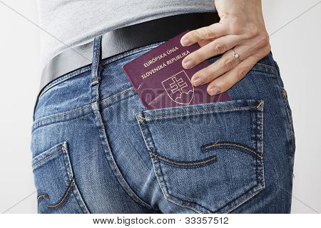 Woman taking passport out of the back pocket