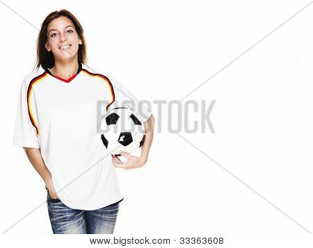 happy woman wearing football shirt holding football