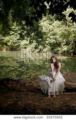 Woman Sitting On A Log, Depressed