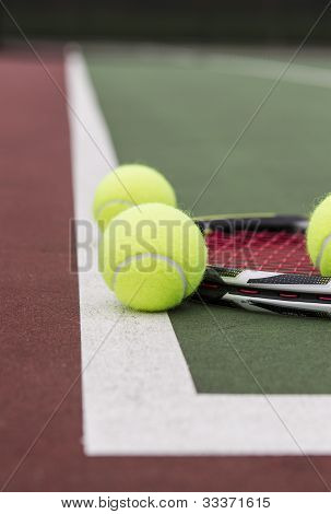 Tennis Equipment Resting On Outdoor Court