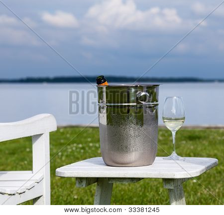Garden Chair And Champagne By Chesapeake Bay