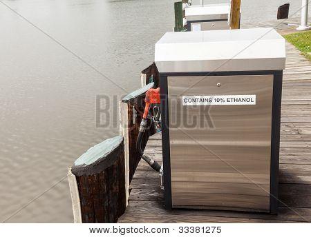 Marine Gasoline Pump In Harbor With Rain