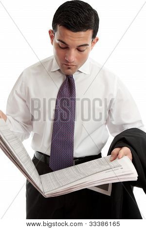 Businessman Reading Stocks And Shares Prices In Newspaper