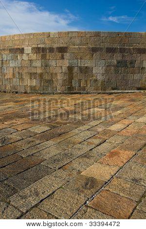 Stone wall and pavement