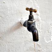 stock photo of spigot  - Detail of a water tap valve faucet spigot - JPG