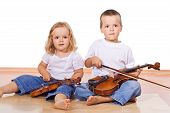 image of little girls  - Little boy and girl with violins sitting on the floor  - JPG