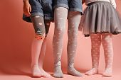 Girlish Legs In Pantyhose On A Pink Background. A Collection Of Childrens Tights For Girls. A Variet poster