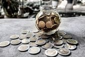 Glass Jar Piggy Bank With Coins. Plan Your Savings, Run A Growing Business For Success And Save For  poster