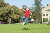 Happy Hip Hop. Happy Small Girl Jump To Music On Green Grass. Little Child Enjoy Happy Music Playing poster