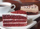 Slice Of Red Velvet Cake On A White Plate. Close Up Of Red Velvet Chocolate Cake And Tiramisu Coffee poster