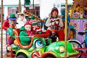 Kids At Christmas Fair. Child At Xmas Market. poster