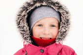 Closeup Portrait Of Cute Adorable Caucasian Smiling Girl Child In Pink Jacket Fur Hood During Cold W poster