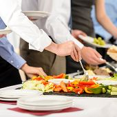 stock photo of buffet lunch  - Business catering people take buffet food during company event - JPG