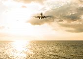 Landscape Of Sunset With Plane On Sky From Phuket At Nai Yang Beach Phuket Province, Thailand. poster