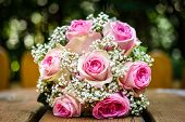 Wedding Bouquet With Pink Roses On Wooden Table. poster