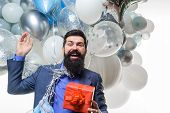 Handsome Man Celebrating Something. Bearded Man In Suit Holds Birthday Gift. Festive Event Or Birthd poster