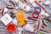 Electrician equipment on gray background, top view poster
