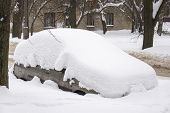Passenger Car Completely Hidden Under A Thick Layer Of Snow. Winter, City Street, Car Buried Under A poster