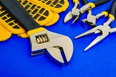 Tools For Master Builder Prepared Before Work On Blue Background poster
