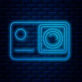 Glowing Neon Line Action Extreme Camera Icon Isolated On Brick Wall Background. Video Camera Equipme poster