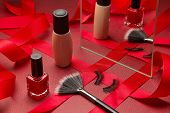Womans Festive Make Up With Foundation, Eye Lashes, Make-up Brush And Red Nail Polish With Mirror An poster