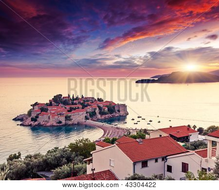 Sveti Stefan, small islet and resort in Montenegro. Overcast sky. Balkans, Adriatic sea, Europe. Beauty world