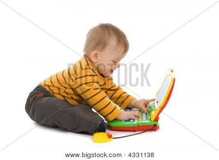 Little Boy Playing With Laptop