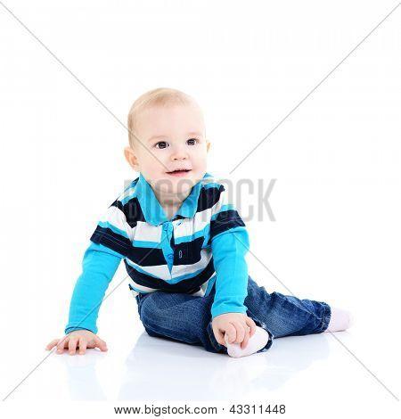 full length portrait of cute happy smiling sitting  little boy toddler, 11 month, studio over white