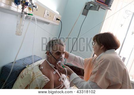 Nurse Setting Oxygen Mask