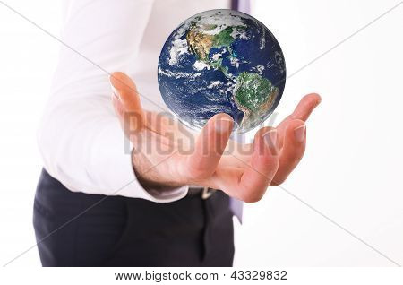 Business man carrying earth.