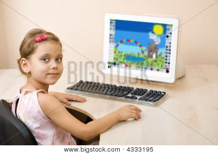 Little Girl Draws At The Computer