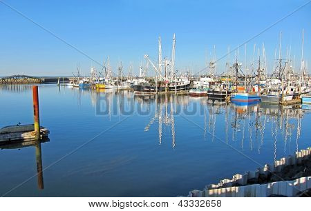 Fishing Boats Docked On Calm Seas