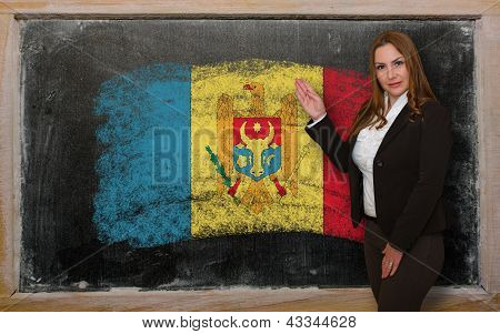 Teacher Showing Flag Ofmoldova On Blackboard For Presentation Marketing And Tourist Advertising