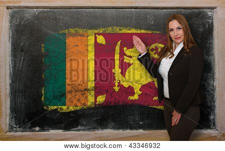 Teacher Showing Flag Ofsrilanka On Blackboard For Presentation Marketing And Tourist Advertising