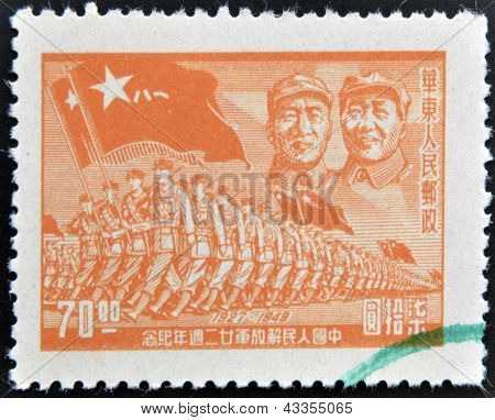 stamp printed in China shows the march of the People's Liberation Army under the image of Mao