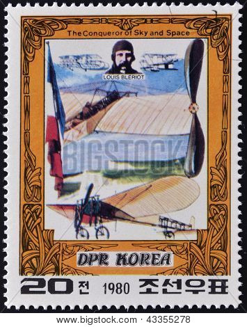 A stamp printed in North Korea shows Louis Bleriot and his plane