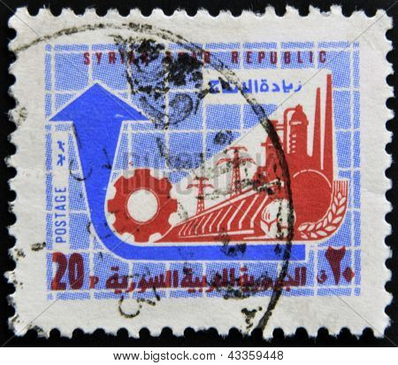 stamp printed in Syria shows factory and power station