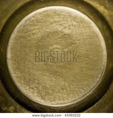Round brass plate texture, old metal background.