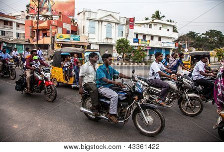 THANJAVUR, INDIA - FEBRUARY 13: Indian riders ride motorbikes on busy road on February 13, 2010 in Thanjavur, India. Motorbike is the most favorite vehicle and most affordable for India.