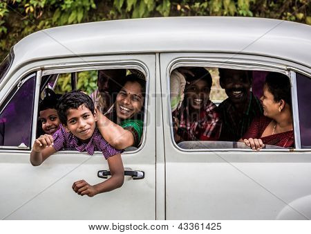 KERALA, INDIA - FEBRUARY 17: Happy unidentified family travels the country, Kerala February 17, 2013 in India. India is the world's second-most populous country. 1210193422 residents in the 2011 provisional census