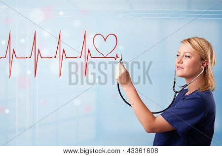 Beautiful young nurse listening to abstract pulse with red heart