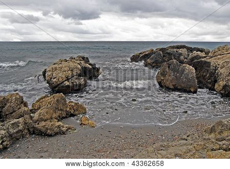 view of rocky beach on a day leaden