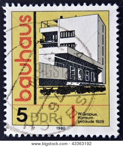 A stamp printed in GDR (East Germany) shows building honoring Bauhaus architectural school