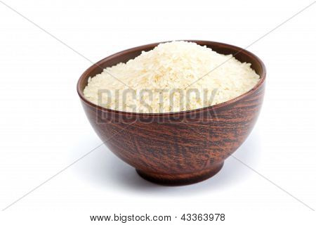 Grains Of Rice In A Bowl Isolated On White Background.