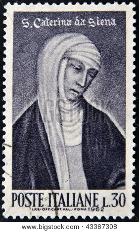 a stamp printed in Italy shows image of St. Catherine of Siena the saint patron of Italy